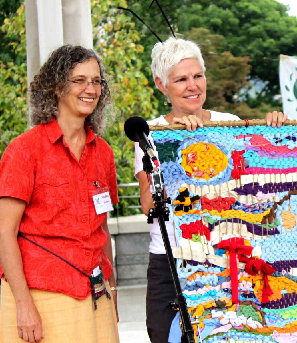 audra-holden-presenting-the-earthloom-tapestry-created-by-organicfest-guests